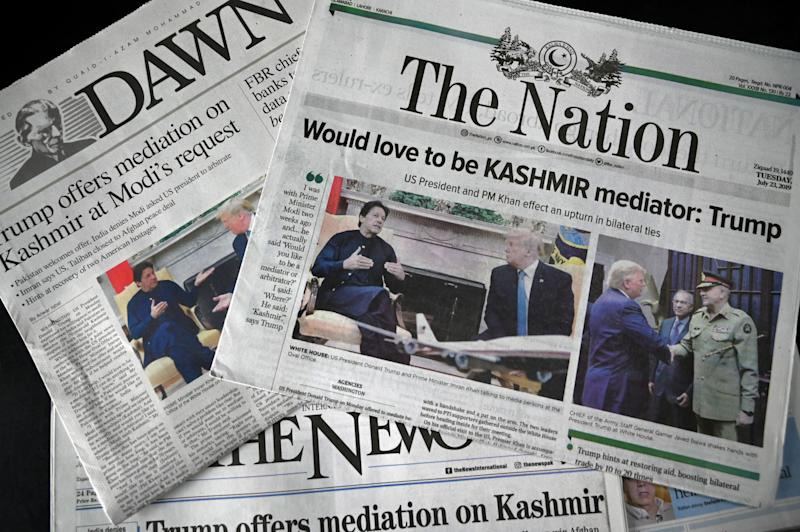 This photo illustration taken in Islamabad on July 23, 2019 shows Pakistani newspapers showing front page coverage of Pakistani Prime Minister Imran Khan meeting US President Donald Trump in the Oval Office at the White House in Washington, DC. (Photo by AAMIR QURESHI / AFP) (Photo credit should read AAMIR QURESHI/AFP/Getty Images)
