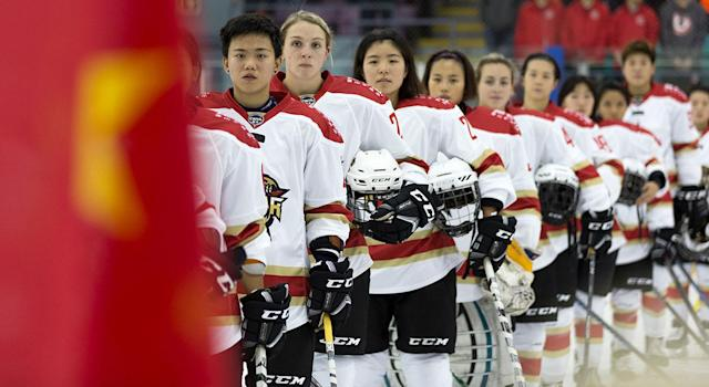 Kunlun Red Star players line up for the national anthems in Markham, Ont., on Oct. 21. (Chris Tanouye/CWHL)