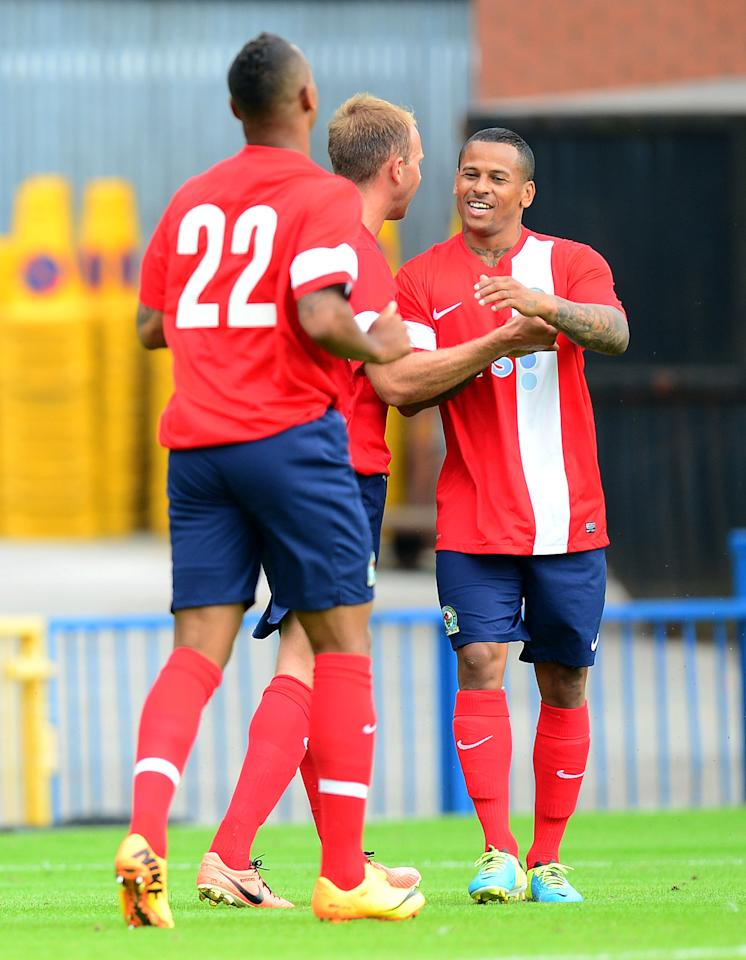 Blackburn Rovers' DJ Campbell celebrates scoring against Rochdale during the Pre-Season Friendly match at Spotlands, Rochadale.