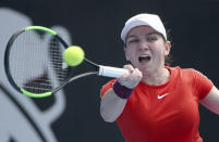 FILE - In this Jan. 9, 2019, file photo, Simona Halep of Romania hits a forehand to Ash Barty of Australia during their women's singles match at the Sydney International tennis tournament in Sydney, Australia.No. 2 Simona Halep – A two-time Grand Slam champion and the runner-up at Melbourne Park in 2018. (AP Photo/Rick Rycroft, File)