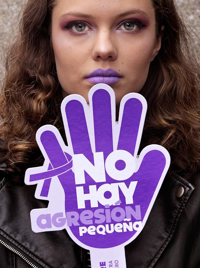 """<p>A woman holds a banner that reads """"There is no little aggression"""" during a gathering held in Gijon, northern Spain, on occasion of the International Day for the Elimination of Violence Against Women, Nov. 25, 2017. (Photo: Alberto Morante/EPA-EFE/REX/Shutterstock) </p>"""