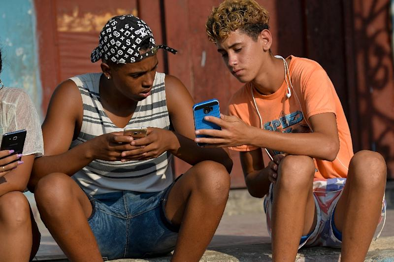 Mobile packages cost up to $30 dollars, putting them out of reach of most Cubans who subsist on that much earned from working in public sector jobs per month (AFP Photo/YAMIL LAGE)