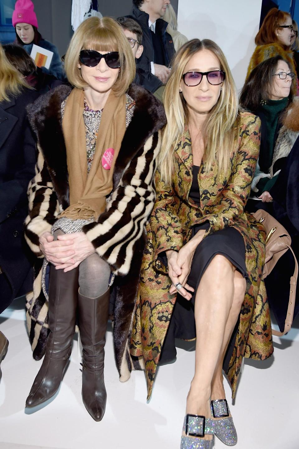 <p>Anna Wintour and Sarah Jessica Parker were both in rather eclectic looks featuring mega printed coats. <i>[Photo: Getty]</i> </p>