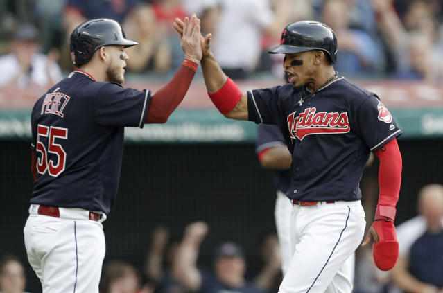 Cleveland Indians' Francisco Lindor, right, and Roberto Perez celebrate after both score on a two-run single hit by Michael Brantley in the third inning of a baseball game against the Houston Astros, Thursday, May 24, 2018, in Cleveland. (AP Photo/Tony Dejak)