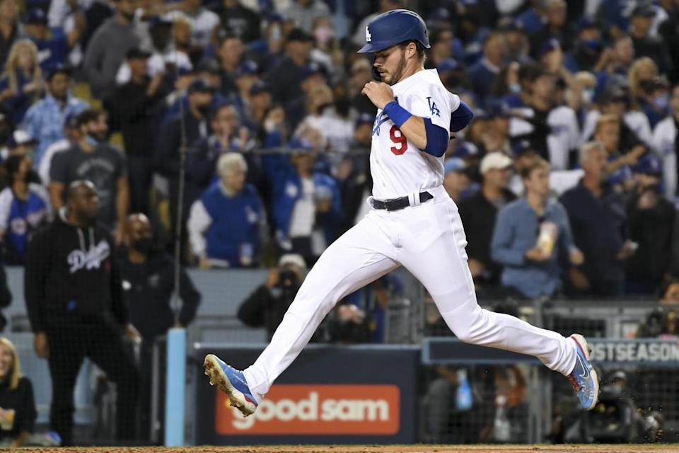 Gavin Lux scores off a sacrifice fly by Chris Taylor during the second inning of Game 4 of the NLDS on Tuesday.