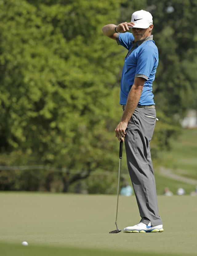 Nick Watney reacts after missing a birdie putt on the ninth hole during the third round of the Wyndham Championship golf tournament in Greensboro, N.C., Saturday, Aug. 16, 2014. (AP Photo/Chuck Burton)