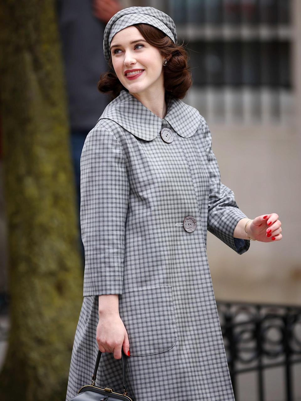 <p>Rachel Brosnahan is spotted in a plaid beret and matching overcoat while filming <em>The Marvelous Mrs. Maisel</em> on Tuesday in N.Y.C.</p>
