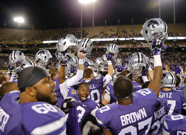 Kansas State players celebrate after the Buffalo Wild Wings Bowl NCAA college football game against Michigan, Saturday, Dec. 28, 2013, in Tempe, Ariz. Kansas State won 31-14. (AP Photo/Matt York)