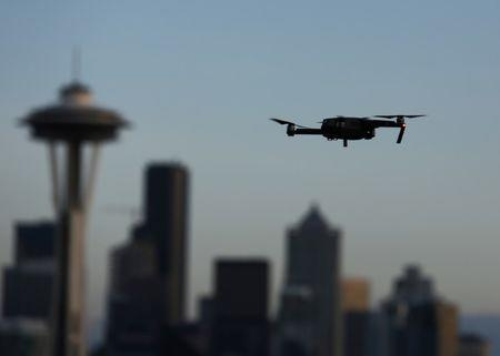 A drone hovers at a viewpoint overlooking the Space Needle and skyline of tech hub Seattle