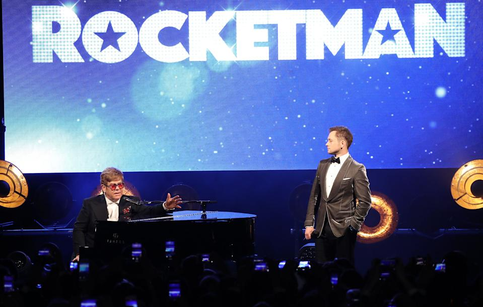 """CANNES, FRANCE - MAY 16: Sir Elton John and Taron Egerton attend the """"Rocketman"""" Gala Party during the 72nd annual Cannes Film Festival on May 16, 2019 in Cannes, France. (Photo by Mike Marsland/WireImage)"""