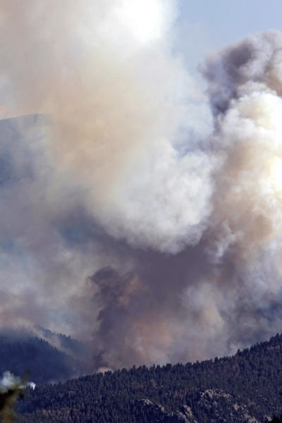 Smoke billows from the High Park Fire west of Fort Collins, Colo., on Monday, June 18, 2012. The wildfire has now burned about 90 square miles and destroyed more than 180 homes. (AP Photo/Ed Andrieski)