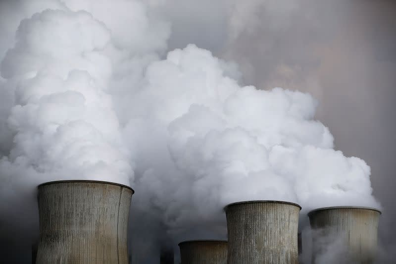 Steam rises from the cooling towers of the coal power plant of RWE in Niederaussem