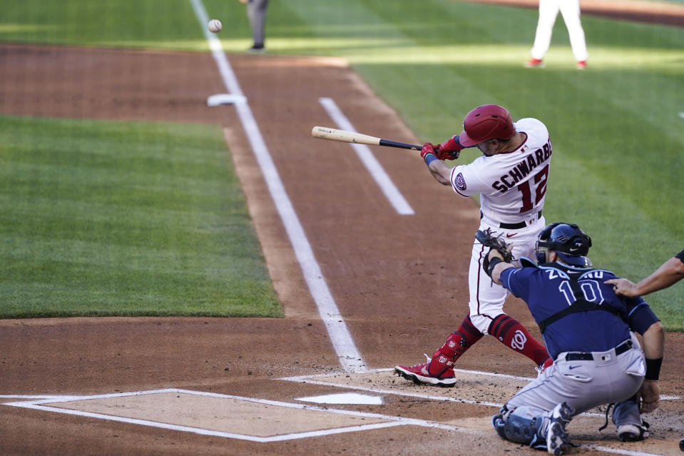 Washington Nationals' Kyle Schwarber hits a solo home run during the first inning of a baseball game against the Tampa Bay Rays at Nationals Park, Tuesday, June 29, 2021, in Washington. (AP Photo/Alex Brandon)