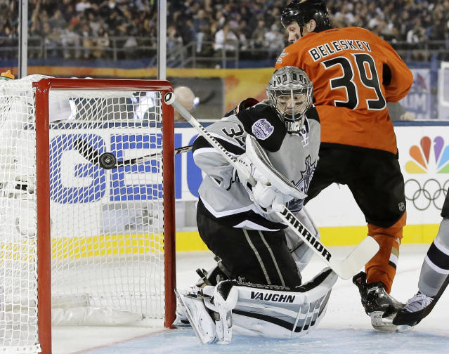 Anaheim Ducks left wing Matt Beleskey scores on Los Angeles Kings goalie Jonathan Quick during the first period of an NHL outdoor hockey game at Dodger Stadium in Los Angeles, Saturday, Jan. 25, 2014. (AP Photo/Chris Carlson)