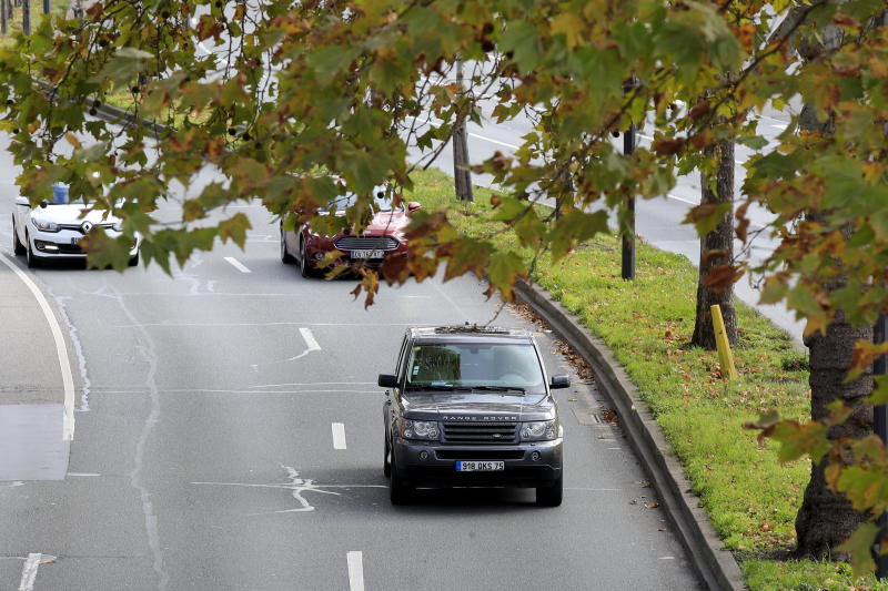 A SUV drives Wednesday, Nov. 13, 2019 in Paris. The world's thirst for oil will continue to grow until the 2030s, with climate-damaging emissions climbing until at least 2040 — and consumers' insatiable appetite for SUVs is a big reason why. (AP Photo/Michel Euler)