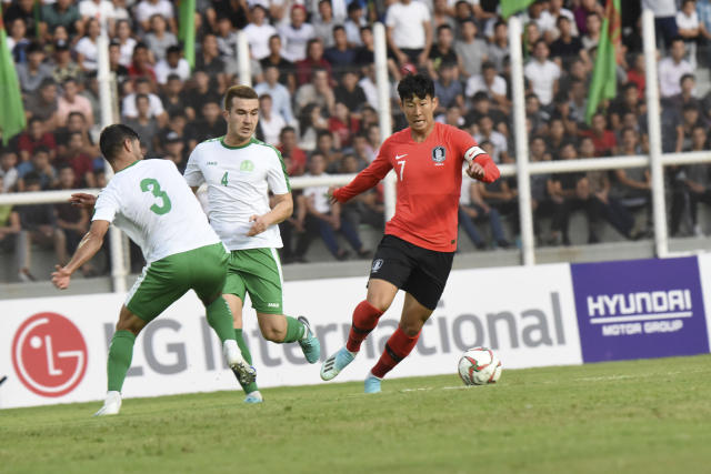South Korea's Son Heung-min, right, controls the ball during the World Cup Group H qualifying soccer match between Turkmenistan and South Korea at the Kopetdag Stadium in Ashgabat, Turkmenistan, Tuesday, Sept. 10, 2019. (AP Photo/Alexander Vershinin)