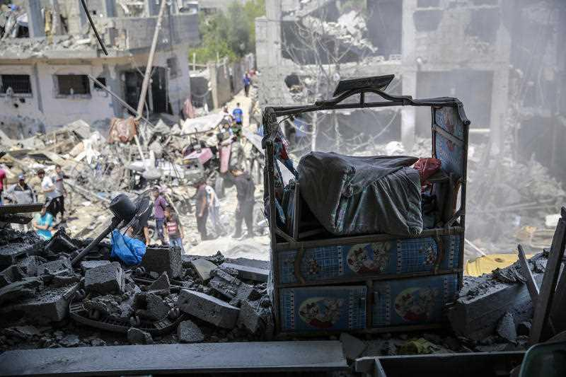 A child's bed seen at the site of destroyed house in the aftermath of Israeli air and artillery strikes as cross-border violence between the Israeli military and Palestinian militants continues in the northern Gaza Strip.