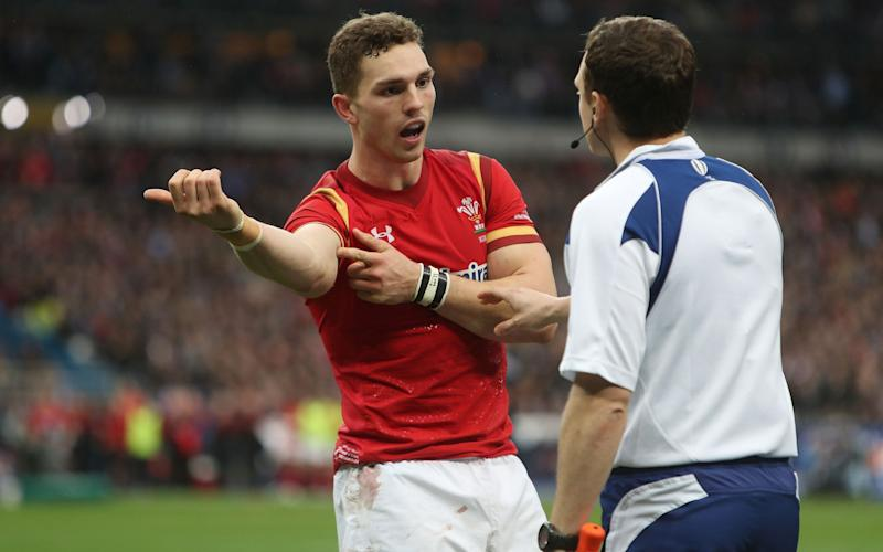 George North shows what he says was a bite mark to the referee - PA Wire