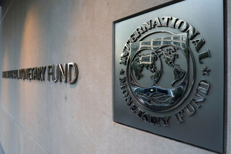 FILE PHOTO: IMF logo is seen outside the headquarters building in Washington