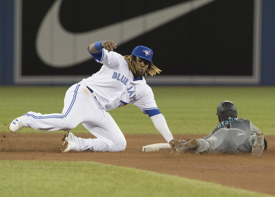 Arizona Diamondbacks' Jarrod Dyson is safe stealing second, beating the tag attempt by Toronto Blue Jays' Vladimir Guerrero Jr. during the seventh inning of a baseball game Friday, June 7, 2019, in Toronto. (Fred Thornhill/The Canadian Press via AP)