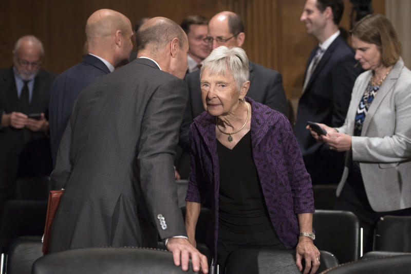 Eugene Scalia talks with his mother Maureen Scalia during a break in his nomination hearing for Labor Secretary before the Senate Committee on Health, Education Labor and Pensions on Capitol Hill, in Washington, Thursday, Sept. 19, 2019. Maureen Scalia is the widow of former Supreme Court Associate Justice Antonin Scalia. (AP Photo/Cliff Owen)