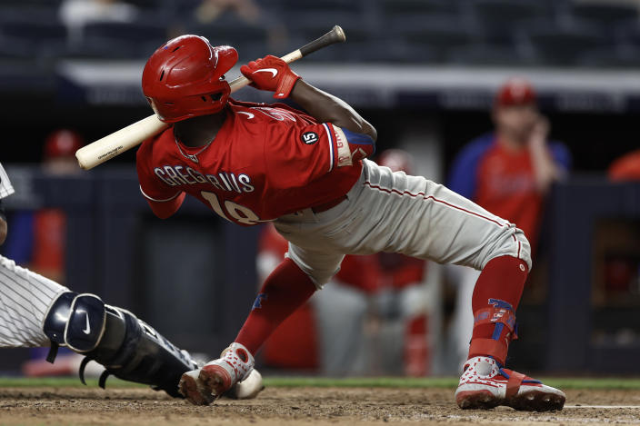 Philadelphia Phillies' Didi Gregorius ducks under a high pitch from the New York Yankees during the ninth inning of a baseball game Wednesday, July 21, 2021, in New York. (AP Photo/Adam Hunger)