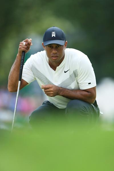 Tiger Woods lines up a putt in the second round of the US PGA Tour BMW Championship at Medinah Country Club