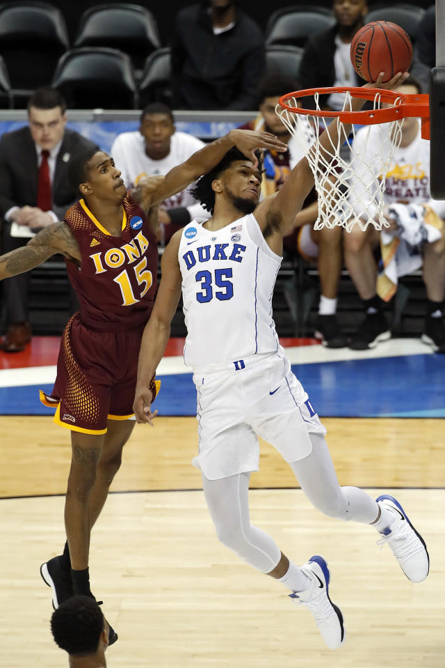 Duke's Marvin Bagley III (35) makes a shot with Iona's Deyshonee Much (15) defending during the first half of an NCAA men's college basketball tournament first-round game, in Pittsburgh, Thursday, March 15, 2018.(AP Photo/Gene J. Puskar)