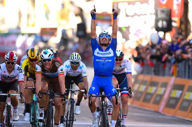 French rider Julian Alaphilippe, right, celebrates as he crosses the finish line to win, as Oliver Naesen, at his left, of AG2R, comes in second, and Michal Kwiatkowski of Team Sky, left, third, after a 10-man sprint at the end of the 291-kilometer (181-mile) route along the Italian Riviera for the 110th edition of the Milano-Sanremo cycling classic, in Sanremo, Italy, Saturday, March 23, 2019. (Dario Belinghieri/ANSA via AP)