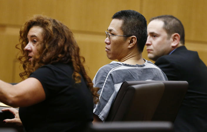 Johnathan A. Doody, awaits to be sentenced by Maricopa County Superior Court Joseph Kreamer on Friday, March 14, 2014 in Phoenix, Ariz. Doody, convicted of killing nine people, including six monks, during a robbery at a Buddhist temple in metro Phoenix was sentenced Friday to 249 years in prison. Doody was founded guilty in January of first-degree murder in the deaths of six monks, one nun and two helpers who were shot in the back of the head and were found arranged face-down in a circle in August 1991 at the Wat Promkunaram temple west of Phoenix. (AP Photo/The Arizona Republic, Rob Schumacher, Pool)