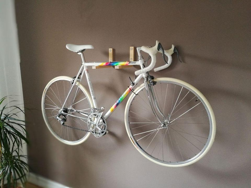 """<p>The legs of an old stool can actually be repurposed to create a wall mount. Not only will it secure a large bicycle, but it will create an intricate wall display.</p><p>See more at <a href=""""https://www.ikeahackers.net/2017/03/frosta-bike-wall-mount.html"""" rel=""""nofollow noopener"""" target=""""_blank"""" data-ylk=""""slk:IKEA Hackers"""" class=""""link rapid-noclick-resp"""">IKEA Hackers</a>.</p><p><a class=""""link rapid-noclick-resp"""" href=""""https://go.redirectingat.com?id=74968X1596630&url=https%3A%2F%2Fwww.ikea.com%2Fus%2Fen%2Fp%2Fkyrre-stool-birch-60416925%2F&sref=https%3A%2F%2Fwww.countryliving.com%2Fhome-maintenance%2Fg37186772%2Fentryway-ikea-hacks%2F"""" rel=""""nofollow noopener"""" target=""""_blank"""" data-ylk=""""slk:BUY NOW"""">BUY NOW</a> <strong><em>Stool, $13</em></strong></p>"""