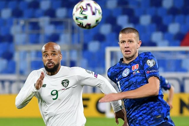 Republic of Ireland striker David McGoldrick (left) battles Slovakia's Denis Vavro