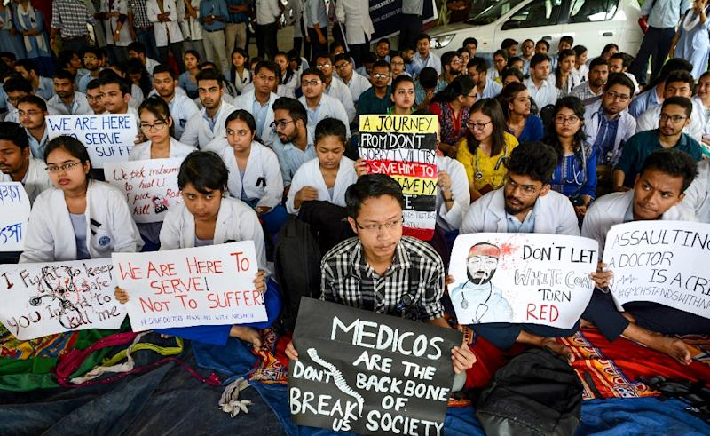 Indian doctors had gone on a nationwide strike to demand better protection from patients and their angry relatives after incidents in West Bengal state (AFP Photo/STR)