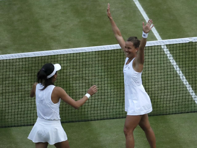 Czech Republic's Barbora Strycova, right, and Taiwan's Su-Wei Hsieh celebrate defeating Canada's Gabriela Dabrowski and China's Yifan Xu in the women's doubles final match of the Wimbledon Tennis Championships in London, Sunday, July 14, 2019. (AP Photo/Ben Curtis)
