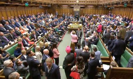 Members of Parliament for the Scottish National Party (SNP) walk out of the House of Commons during Prime Minister's Questions after their leader Ian Blackford was asked to leave by the Speaker, in London, Britain, June 13, 2018. Parliament TV handout via REUTERS