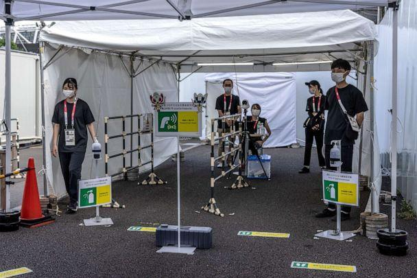PHOTO: Staff operate coronavirus health screening at an entrance to Tokyo Stadium, the Olympic venue for football, rugby and modern pentathlon, on July 25, 2021 in Tokyo, Japan. (Carl Court/Getty Images)