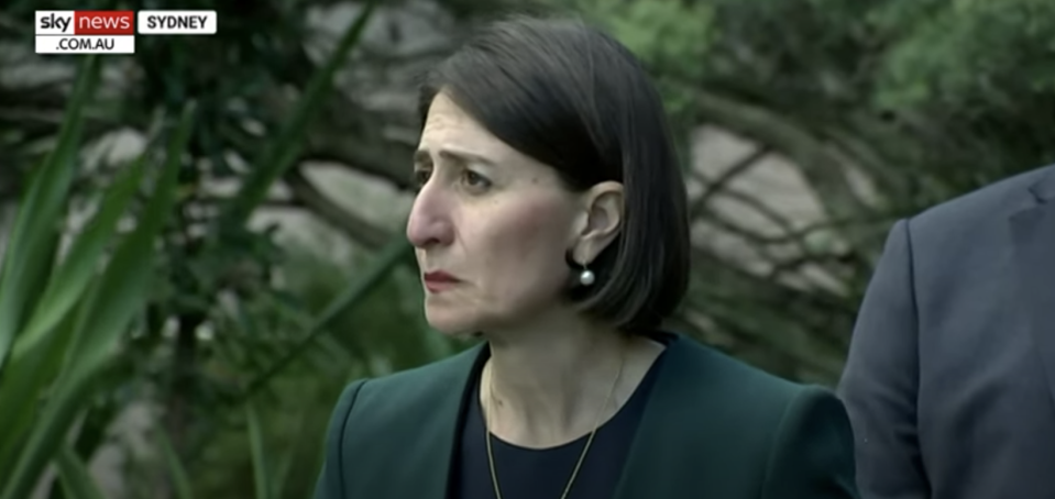 Pictured is Gladys Berejiklian suppressing her emotion during a press conference on October 12.