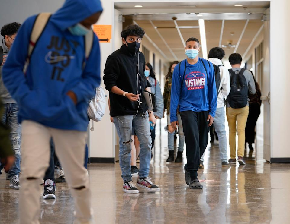 Students return to West Mesa High School on the second day of full-time, in-person classes. Most of the school's 1,757 students chose to stay remote, but 495 returned in person.