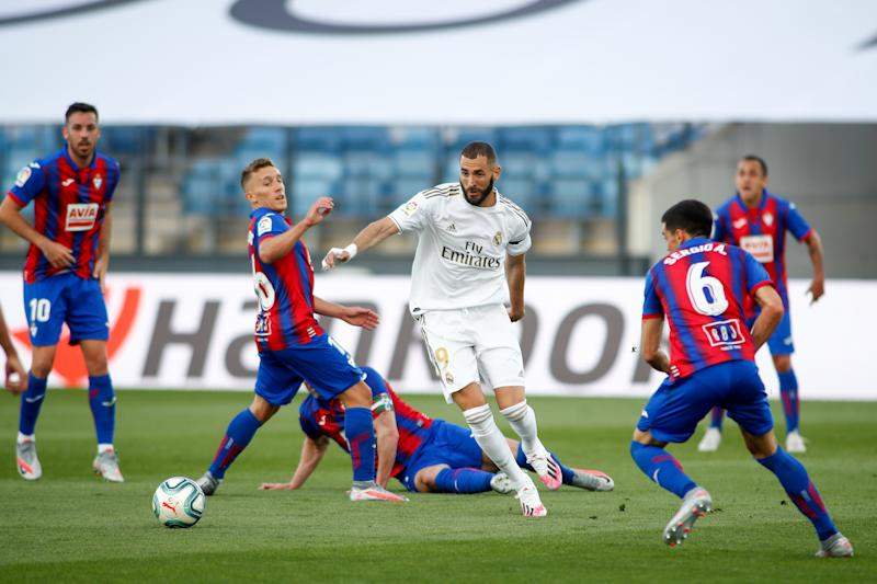 VALDEBEBAS, SPAIN - JUNE 14: Karim Benzema of Real Madrid and Pablo De Blasis of Eibar in action during the La Liga football match between Real Madrid and SD Eibar at Alfredo Di Stefano Stadium in the restart of the Primera Division tournament after to the coronavirus COVID19 pandemic, on June 14, 2020 in Valdebebas, Madrid, Spain. (Photo by Oscar J. Barroso / AFP7 / Europa Press Sports via Getty Images)