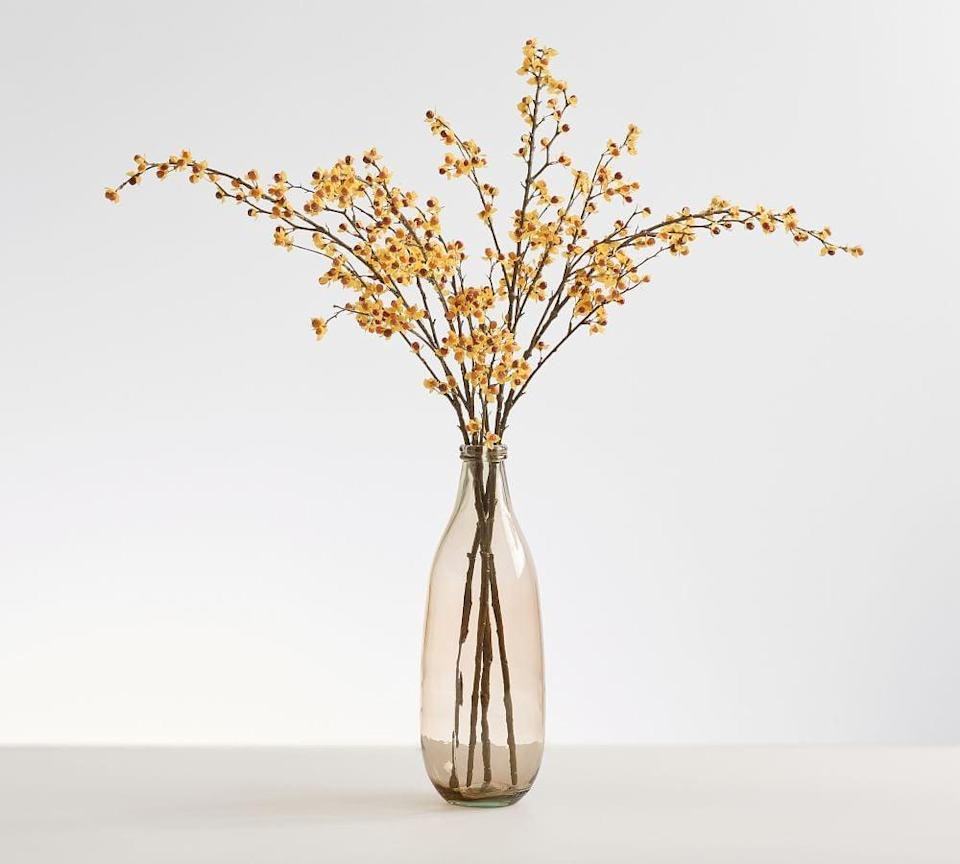 <p>Paired with a stylish vase, this <span>Pottery Barn Faux Autumn Bittersweet Branch</span> ($40) make a statement in any home! It's perfect for adding an oomph of decor to any space.</p>