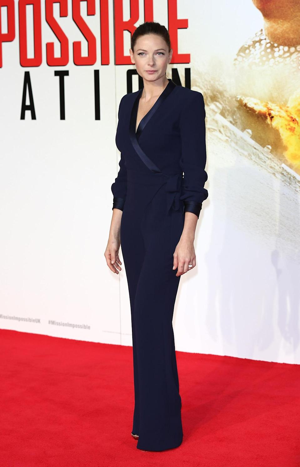 <p>Rebecca Ferguson wears a plunging navy jumpsuit by Diane von Furstenberg.</p><p>Rebecca Ferguson attended the London premiere of her new film, <i>Mission Impossible: Rogue Nation</i>, in a menswear-inspired jumpsuit by Diane von Furstenberg.<br><br></p>