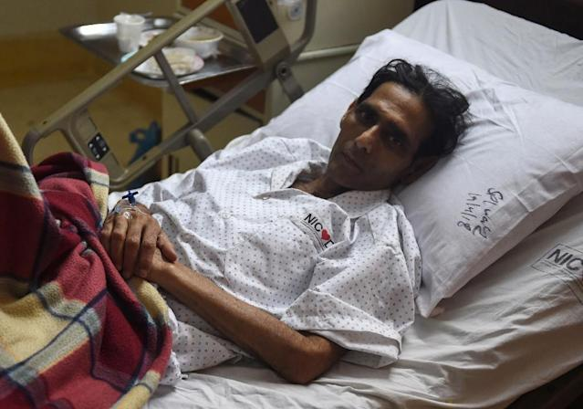 Pakistani former field hockey goalkeeper Mansoor Ahmed, who has died aged 50, had been suffering for weeks from complications stemming from a pacemaker and stents implanted in his heart (AFP Photo/RIZWAN TABASSUM)
