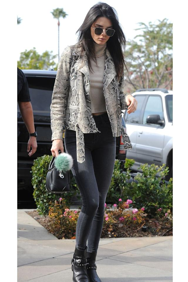 <p>Jenner looked sleek in a snakeskin jacket, greige turtleneck and black skinnies by Citizens of Humanity. </p>