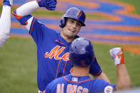New York Mets' Brandon Nimmo, left, celebrates with Pete Alonso after hitting a solo home run during the first inning of a spring training baseball game against the Washington Nationals, Thursday, March 4, 2021, in Port St. Lucie, Fla. (AP Photo/Lynne Sladky)
