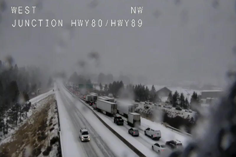 "In this still image taken from a Caltrans remote video traffic camera, traffic is stopped along Interstate 80 because of multiple spinouts, Tuesday, Nov. 26, 2019, in Truckee, Calif. Northern California and southern Oregon residents are bracing for a ""bomb cyclone"" weather phenomenon that's expected at one of the busiest travel times of the year. The National Weather Service says the storm expected Tuesday into Wednesday could be like nothing experienced in the area for 20 years. (Caltrans via AP)"