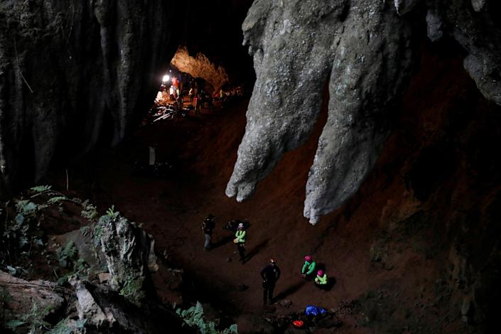<p>Rescue workers are seen in the Tham Luang cave during a search for 12 members of an under-16 soccer team and their coach, in the northern province of Chiang Rai, Thailand, June 27, 2018. (Photo: Soe Zeya Tun/Reuters) </p>