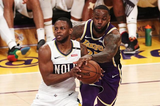 "LeBron James swipes for the ball against <a class=""link rapid-noclick-resp"" href=""/nba/players/5080/"" data-ylk=""slk:Darius Miller"">Darius Miller</a> of the Pelicans during the first half Wednesday in Los Angeles. (Getty Images)"
