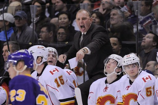 Calgary Flames head coach Brent Sutter yells during the third period of their NHL hockey game against the Los Angeles Kings, Saturday, Feb. 18, 2012, in Los Angeles. The Flames won 1-0. (AP Photo/Mark J. Terrill)