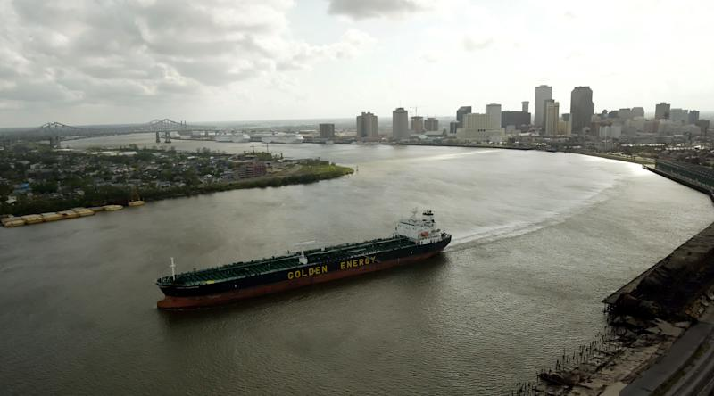 FILE - In this Sunday, Sept. 25, 2005 file picture, a tanker ship travels along the Mississippi River near downtown New Orleans. Flowing naturally or overflowing menacingly, it is impossible to underestimate the Mississippi River's importance to the American economy and psyche. (AP Photo/David J. Phillip)
