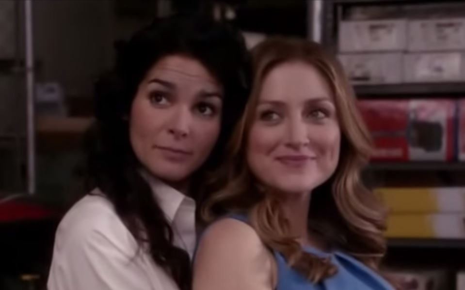 Jane Rizzoli holds Maura Isles from behind as they both smile